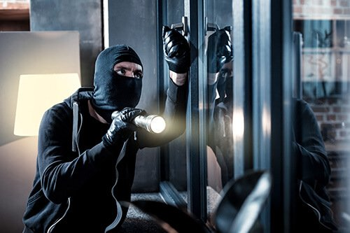 burglar getting into home before home security survey